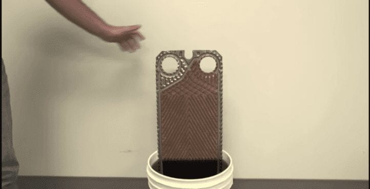 RYDLYME cleans a heat exchanger plate